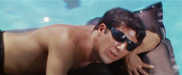 Benjamin's life: lying in the pool and visiting Mrs. Robinson