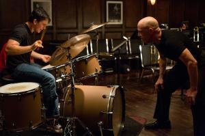 Andrew Neyman (Miles Teller) and Terrence Fletcher (J.K. Simmons)